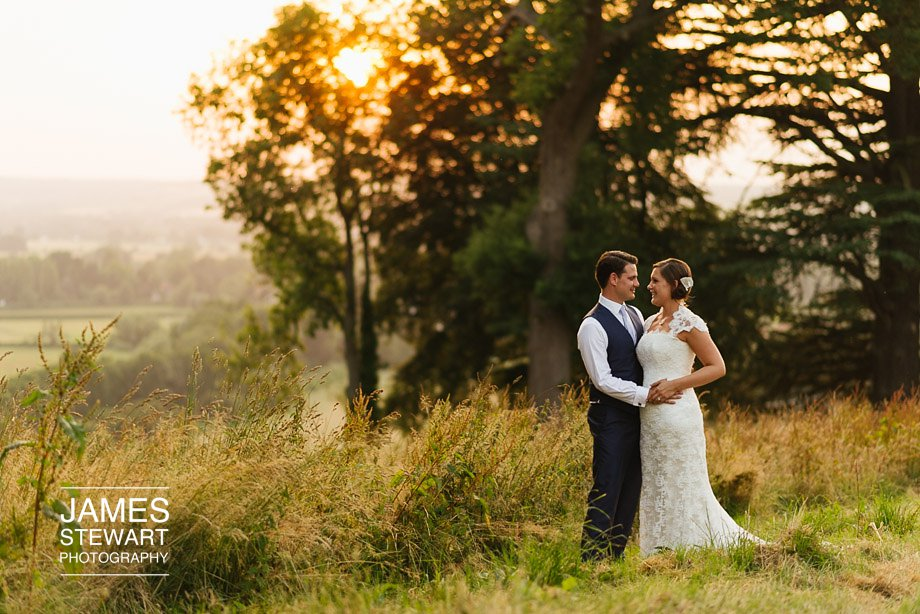bride and groom shot at sunset