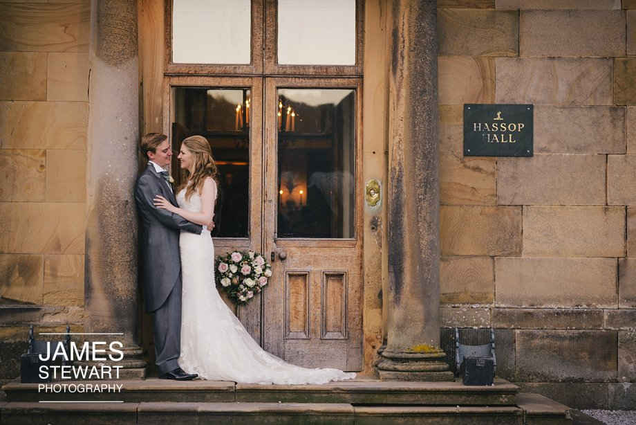 bride and groom outside hassop hall's main entrance